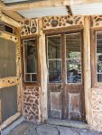 Cordwood infill surrounds second-hand doors and windows