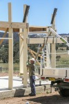 Lifting the hardwood ring beam into place.