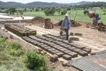 Rosemary making mud bricks.
